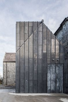 Dublin-based firm McCullough Mulvin Architects was commissioned by the local council to convert a building—formerly St Mary's Church, into a museum of medieval art. Architecture Design, Minimalist Architecture, Contemporary Architecture, Watercolor Architecture, Chinese Architecture, Architecture Office, Futuristic Architecture, Monuments, Metal Cladding