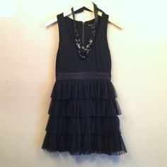 """F21 cocktail dress Black cocktail/party dress from Forever 21, rayon/poly/spandex blend. Cute satin band accentuates waist line, zips up the back with cool exposed zipper detail. Flouncy skirt makes any night out more fun! Approx 31"""" from shoulder to hem. Size Small. Like new condition. Forever 21 Dresses"""
