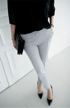 Elegant Business Outfit - Grey tailored pants / trousers, black simple blouse, black pointy heels and black small clutch.