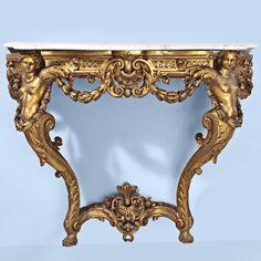 Consola de adosar Fernando VI-Carlos III en madera tallada y dorada.                                                                                                                                                                                 Más