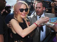"Before heading to yet another round of rehab, Lindsay Lohan, in jet black modernized wayfarers,  fit in time to make an appearance on the ""Late Show""!"