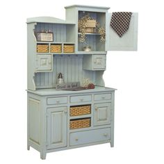 Pine wood china cabinet in seafoam with multiple drawers and handmade woven storage baskets. Made in the USA.  Product: China ca...