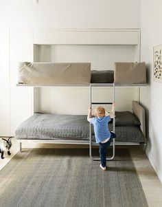 The bunk bed, the Lollipop IN model from Resource Furniture, stows away flushto the wall when not in use.