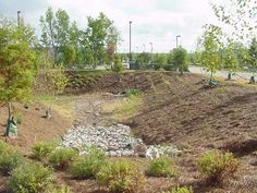 dry detention basin - stores storm water to allow it to percolate more slowly into the system