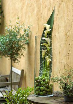 Floral arrangement - Calla Lilies on a big leaf in a clear glass ~ Krista Verwimp Deco Floral, Arte Floral, Floral Design, Ikebana, Flower Centerpieces, Flower Decorations, Flower Show, Flower Art, Contemporary Flower Arrangements