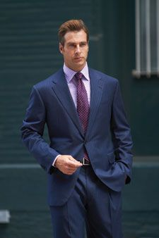 Blue suit, purple gingham shirt, grey tie and brown suede lace ups ...