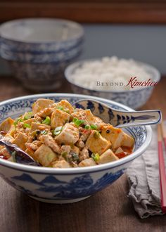 Mapo tofu is a famous Sichuan style tofu dish. Minced pork and soft tofu cubes are seasoned with Chinese doubanjiang paste and chicken stock. Spicy? Oh, yes!