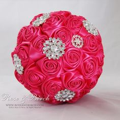 Medium sized bridal/wedding bouquet in hot pink and white with gorgeous bling brooches, buttons and crystals. www.roseandbirch.com  Handmade alternative wedding bridal bouquet fabric ribbon roses brooches brooch