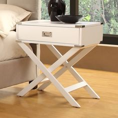 Decided on this for a night stand in the guest room. I love the way the legs look like a luggage rack.    Neo White Box Accent Table with X Leg | Overstock.com