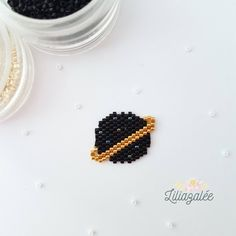 Items similar to Brooch beads Miyuki - black planet on Etsy Loom Bracelet Patterns, Beaded Earrings Patterns, Bead Loom Patterns, Beaded Brooch, Beading Patterns, Brooch Pin, Bead Embroidery Jewelry, Fabric Jewelry, Beaded Embroidery