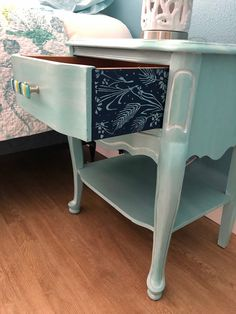French style nightstand that I painted with a combination of General Finishes Milk Paint.  I designed the handles with fused glass.  The roll on stencil pattern really gave this piece an extra pop.