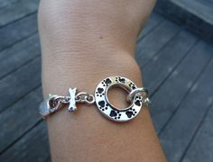 Sterling Silver Circle of Paw Prints Bracelet. $64.00, via Etsy.  I love my new bracelet!