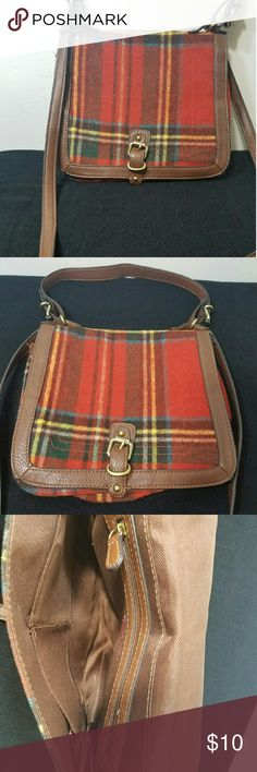 Plaid flannel and faux leather shoulder bag Orange/red plaid almost like a flannel material with a brown trim. Shoulder / crossbody strap is removable but not adjustable. Good condition, some wear. Snap closure and 3 pockets in the inside Merona Bags Shoulder Bags