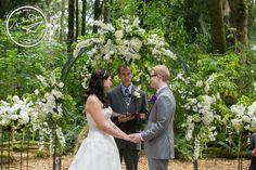 White lilly, hydrangea, & delphiniums ceremony arch florals by Fena Flowers #weddingflowers Amelia Soper Photography