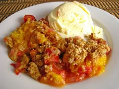 MANGO & RHUBARB CRUMBLE  Ingredients:  1/4 cup sugar  2 tablespoons cornstarch  3 cups mango (diced)  2 cups rhubarb (cut into 1 inch pieces)  1 tablespoon lemon juice  1 teaspoon ginger (grated)  2/3 cup flour  1/3 cup rolled oats  1/3 cup coconut (unsweetened)  2/3 cup brown sugar  1/3 cup butter (melted)