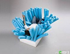 Haha!  Bye-Bye Yoga Ball!  This will be the next thing I'm required to provide for all those ADHD kids!  NoodleBed: Made with Pool Noodles