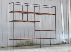Muriel Coleman Room Divider Shelving for Pacifica 1952 | From a unique collection of antique and modern shelves at https://www.1stdibs.com/furniture/storage-case-pieces/shelves/