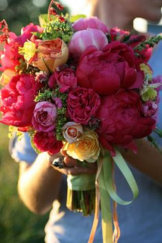 Designed by Floret Flower Farm, bridal bouquet of peonies and garden roses.