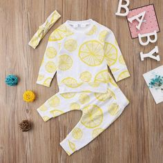 Two Piece Lemon Squeeze Pajamas With Matching Headband from kidspetite.com! Adorable & affordable baby, toddler & kids clothing. Shop from one of the best providers of children apparel at Kids Petite. FREE Worldwide Shipping to over 230+ countries ✈️ www.kidspetite.com #newborn #boy #pajamas #baby #clothing #infant Matching Shirts, Matching Outfits, Tops For Leggings, Leggings Are Not Pants, Baby Girl Pajamas, Lemon Top, How To Squeeze Lemons, Baby Outfits Newborn, Fashion Fabric