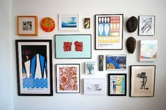 A collage of framed art on a gallery wall ------------------------- #picture #frames #gallery #wall #ideas