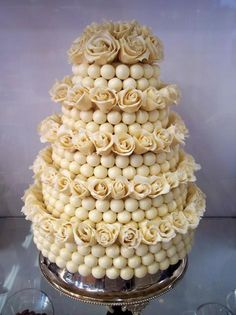 Five-tier Lindor ball wedding cake decorated with edible chocolate roses.They had me at Lindor Ball! White Chocolate is my FAVORITE! Alternative Wedding Cakes, Unusual Wedding Cakes, Wedding Cake Alternatives, Beautiful Cakes, Amazing Cakes, Cake Pops, Lindt Truffles, Chocolate Dreams, Chocolate Roses