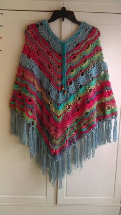 Check out this item in my Etsy shop https://www.etsy.com/listing/484607200/colorful-poncho-made-with-unforgettable