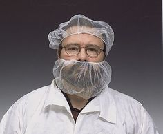 though it's hard to wear a beard net and not a smile, this worker manages to maintain a stoic disposition.
