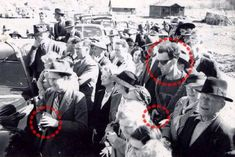 The Time Traveler: People believe that this photograph, taken in 1941 at the re-opening of the South Forks Bridge in Gold Bridge, Canada, is depicting a man in seemingly modern dress and style, with a camera that is advanced well beyond its time. The circle on the left illustrates a man with a camera typical to the time-period.