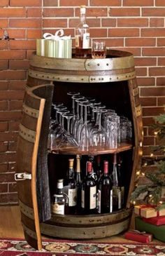 Wine barrel bar table and many other DIY furniture made from wooden barrels . build your own wooden barrel diy furniture wine glasses storage space wine bottles More ideas like this project @ co.
