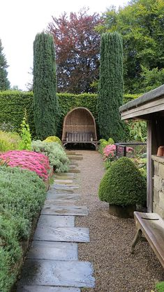 The Kitchen Garden with Bench Seat and Wicker Canopy