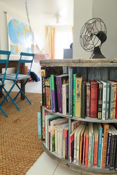 Originally designed as a homeschool classroom, this space (complete with reading hammock in the back) is perfect for kids to do their homework, work on crafts and play.