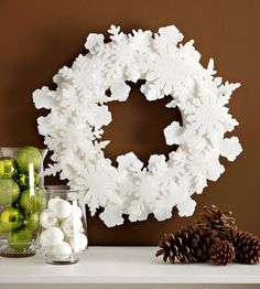 Snowflake Wreath Soft white felt snowflakes, fashioned from our free patterns, encircle a store-bought wreath form. Sprinkle the flakes with glitter for a decoration that glistens for Christmas and lasts all winter long. Learn more about this project. Homemade Christmas Wreaths, Holiday Wreaths, Holiday Crafts, Christmas Decorations, Winter Wreaths, Felt Decorations, Holiday Decor, Snowflake Wreath, Christmas Snowflakes