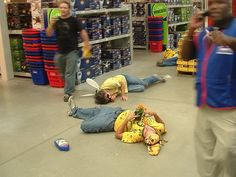 """Activists """"Die-In"""" at Lowe's to raise awareness about bee-killing pesticide products & pre-treated plants. It's time to prepare for the Swarm - https://www.facebook.com/events/273985702772399/ ----- Support Bee Against Monsanto organizers with an order from their online store: https://beeagainstmonsanto.bigcartel.com/admin/ (You can even still request Free patches!)"""
