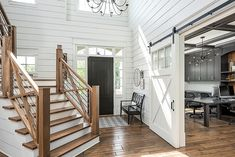 Modern farmhouse entryway light with the two tone staircase and sliding farmhouse door pulls this whole look together. Design by Picture Perfect House Farmhouse Interior, Farmhouse Design, Modern Farmhouse, Farmhouse Style, Farmhouse Decor, White Farmhouse, Farmhouse Stairs, Farmhouse Ideas, Farmhouse Layout