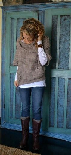 tan off-shoulder sweater, white long sleeve shirt, light blue jeans, brown boots
