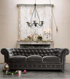 Love the shabby architectural elements with this rich gray velvet sofa. Image via City Farmhouse on facebook.
