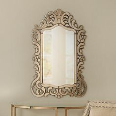 Make a stylish statement with this chic openwork wall mirror in a tinted bronze finish with a beveled glass edge.