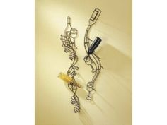 Set of 2 Wire Form Wall Mounted Wine Bottle Racks by Midwest-CBK. $61.13. Brand New. Primary Material: IRON. Division: Accent Furniture. Each rack features a swirling wine themed motif. Black bronze finish. Material(s): Iron. Dimensions of each rack:. Large: 45H x 8L x 4W. Small: 42H x 8L x 4W