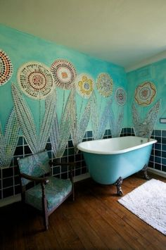 Fun cool mosaic flowers!  ...and a chair by the tub, so one and creepishly watch one bathe. O-o
