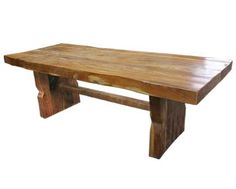 4 inch thick dining table made with recycled wood beams from demolished buildings in India then imported to our warehouse outlet in San Diego