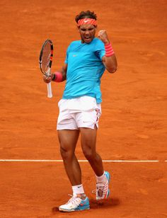 Rafael Nadal Photos - Mutua Madrid Open - Day Five - ZimbioRafael Nadal of Spain celebrates a point against Steve Johnson of the United States in their second round match during day five of the Mutua Madrid Open tennis tournament at the Caja Magica on May 6, 2015 in Madrid, Spain.