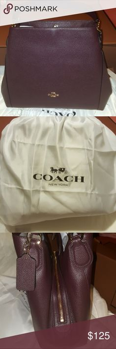 Brand new designer Coach handbag Brand new dark purple designer Coach handbag. Polished leather inside zip pocket. Dust bag included. Coach Bags Satchels