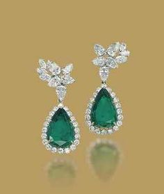 A PAIR OF COLOMBIAN EMERALD AND DIAMOND EARRINGS Each pendant set with a pear-shaped emerald in a brilliant-cut diamond surround to the pear-shaped and marquise-cut diamond cluster top.