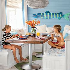 "Create a dining nook reminiscent of a boat galley: ""Squeezing around the table is part of the experience!,"" says designer Dana Small."