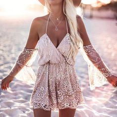 "Made out of beautiful sequins and lace this gorgeous romper is right out of a fantasy romance novel. Perfect for casual outings or any summer activity this romper is sure to have your friends asking ""Where'd you get that?"""
