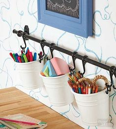 The humble towel bar proves its tidying potential.