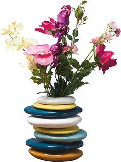 Diese Vase ist ein ungewöhnlich schönes Accessoire. Verschieden farbige Elemente mit unterschiedlichen Formen sind stilvoll aufeinander gestapelt. So bietet die Vase viel Platz für Ihre bunten Blüten, Gräser und Äste. Die Blumenvase ist ein außergewöhnlicher Hingucker!