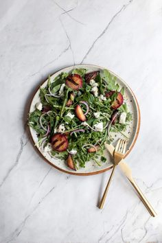 Seriously the most delicious salad with grilled plums, arugula, red onions, fresh herbs, goat cheese and the most amazing homemade lemon vinaigrette. Spice up holiday meal plans with this incredibly simple and unexpected addition. #appetizer #salad #sidedish #quickandeasy