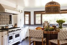 Eclectic kitchen features a woven basket light pendant illuminating a chocolate brown kitchen ...