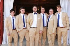 Tan-Groomsmen-Suits  I'm thinking tan suits, blue accents... Barn wedding?
